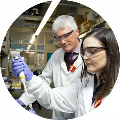Dr. Raymond Reilly and Valerie Facca working in lab