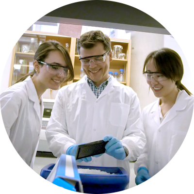 Professor Keith Pardee alongside lab members Seray Cicek (left) and Livia Guo (right)