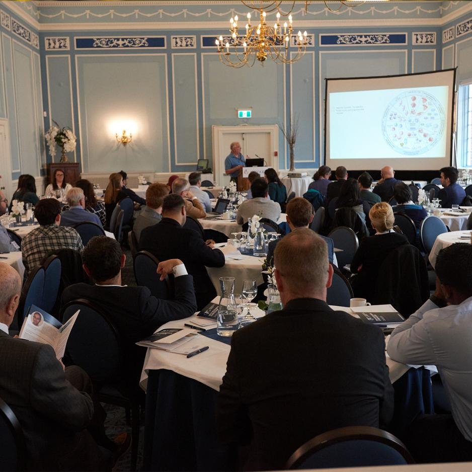Photo of audience listening to keynote at the Centre for Pharmaceutical Oncology Symposium